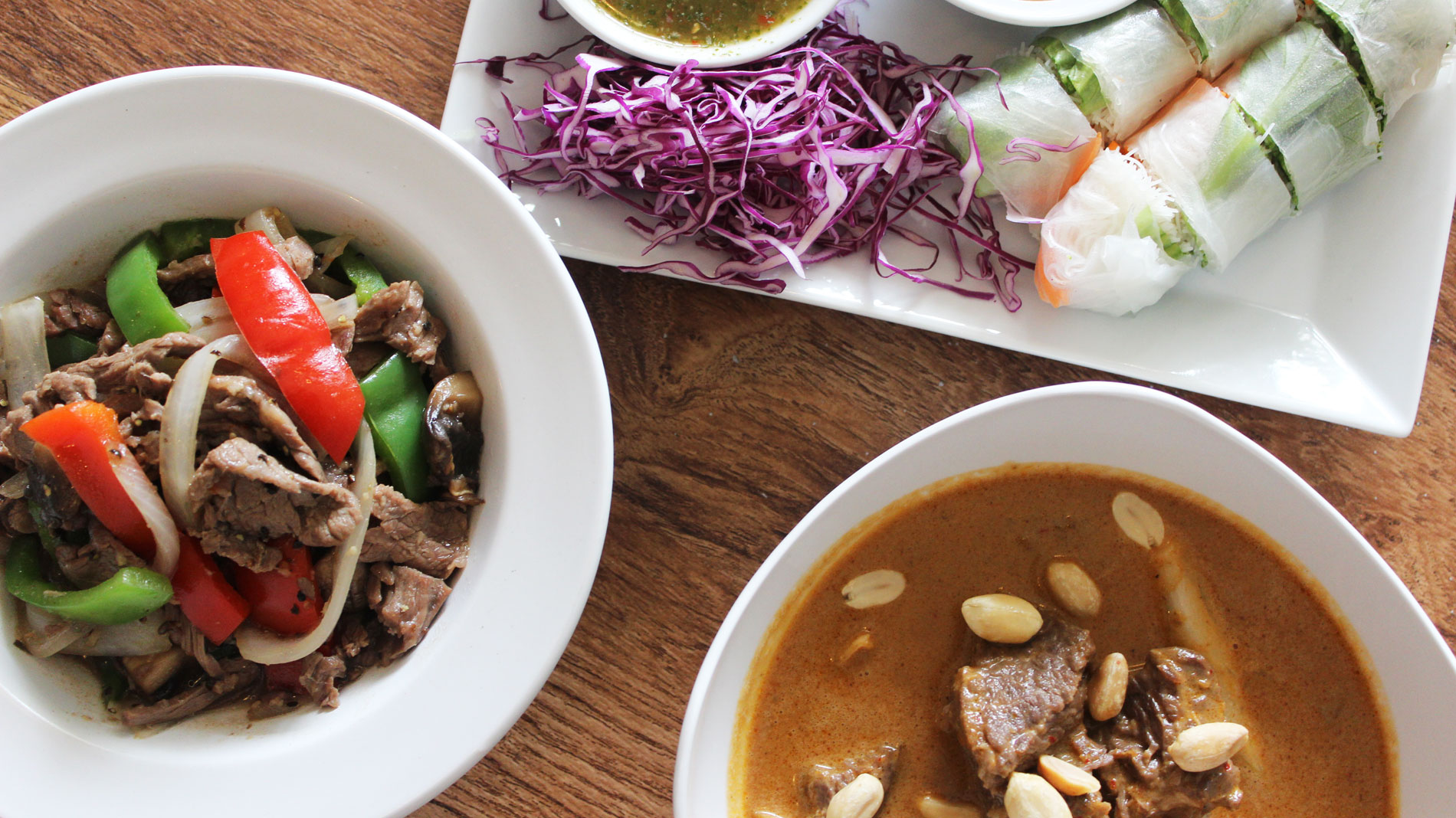 Clockwise, from left, black pepper beef, summer rolls and Massaman beef curry at Thai Table in Maplewood, Missouri.