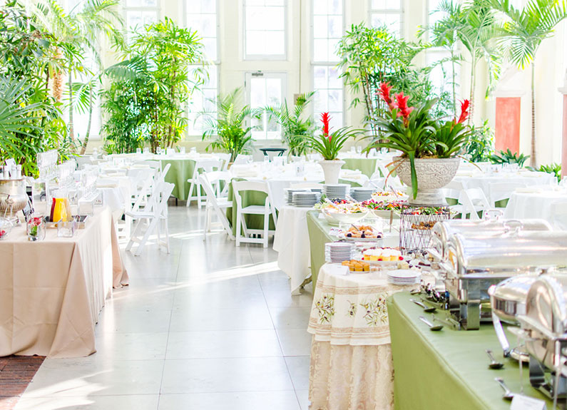a sunlight room set up for brunch