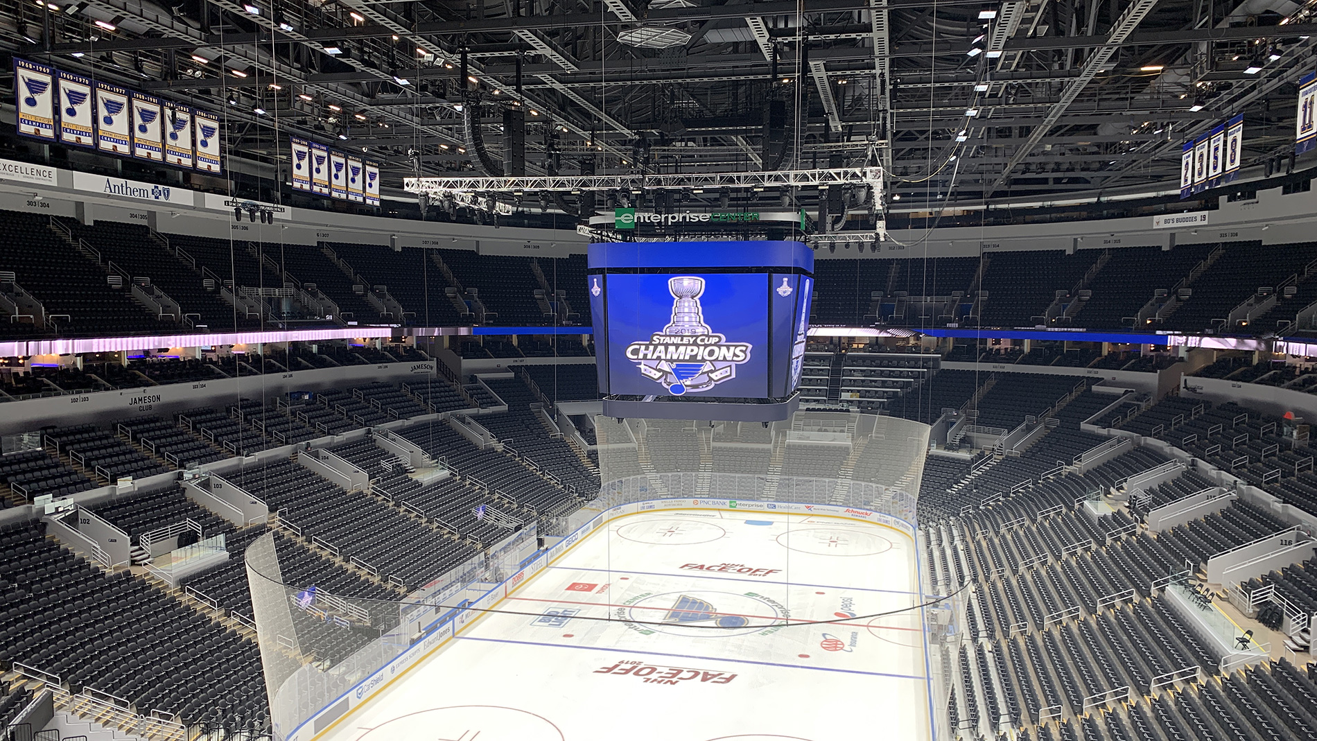 an empty ice rink with a jumbotron