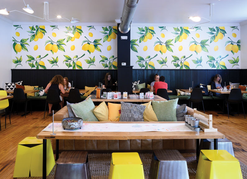 a cafe with lemon wallpaper