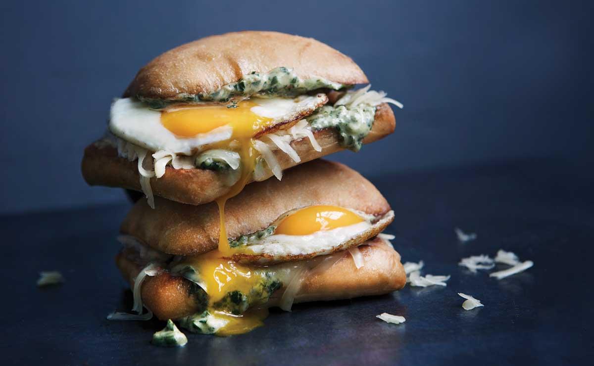 chimichurri egg sandwich with runny yolk