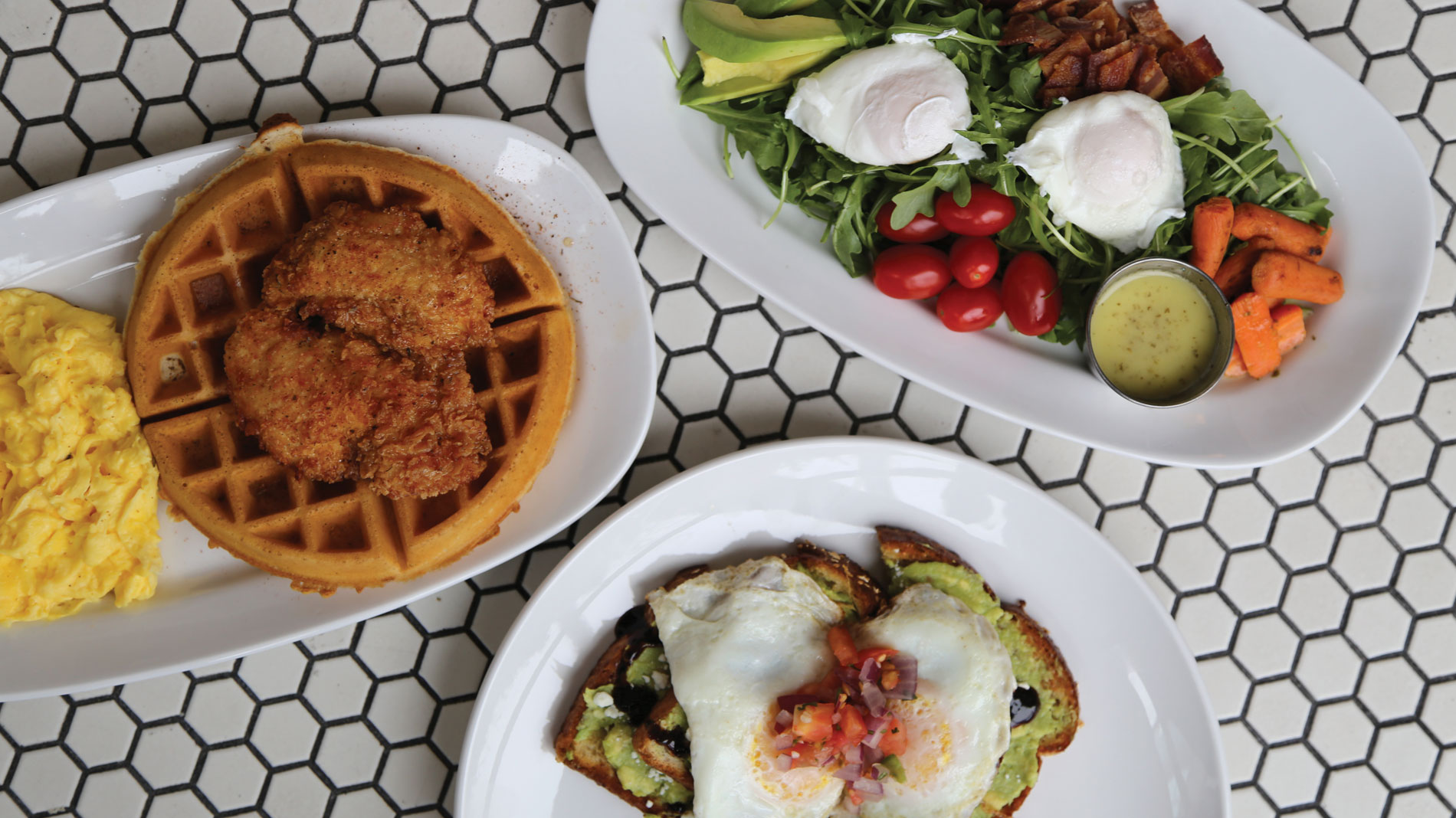 chicken and waffles, breakfast salad and avocado toast from kingside diner in clayton