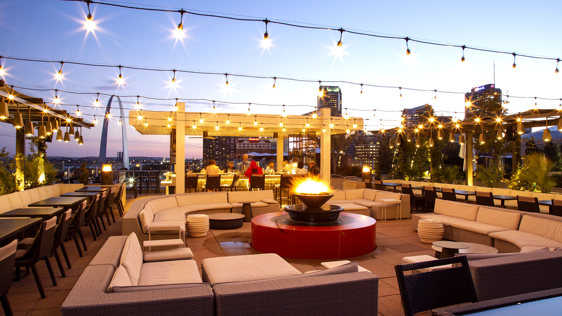 a hotel rooftop patio with a bonfire