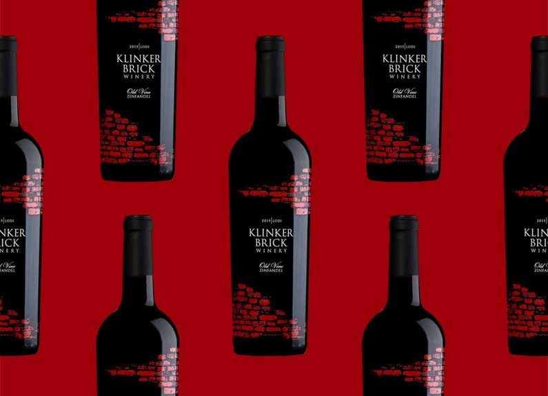 black bottles of wine on a red background