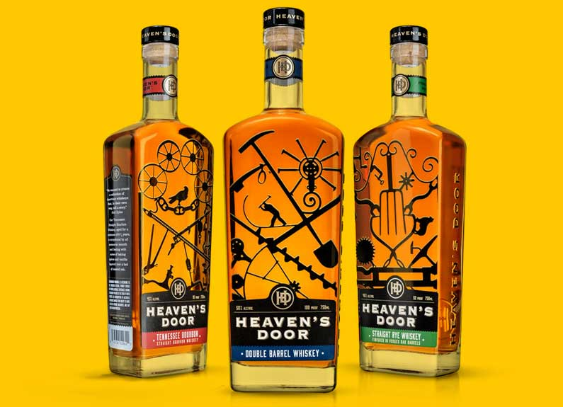 three bottles of heaven's door whiskey on a yellow background