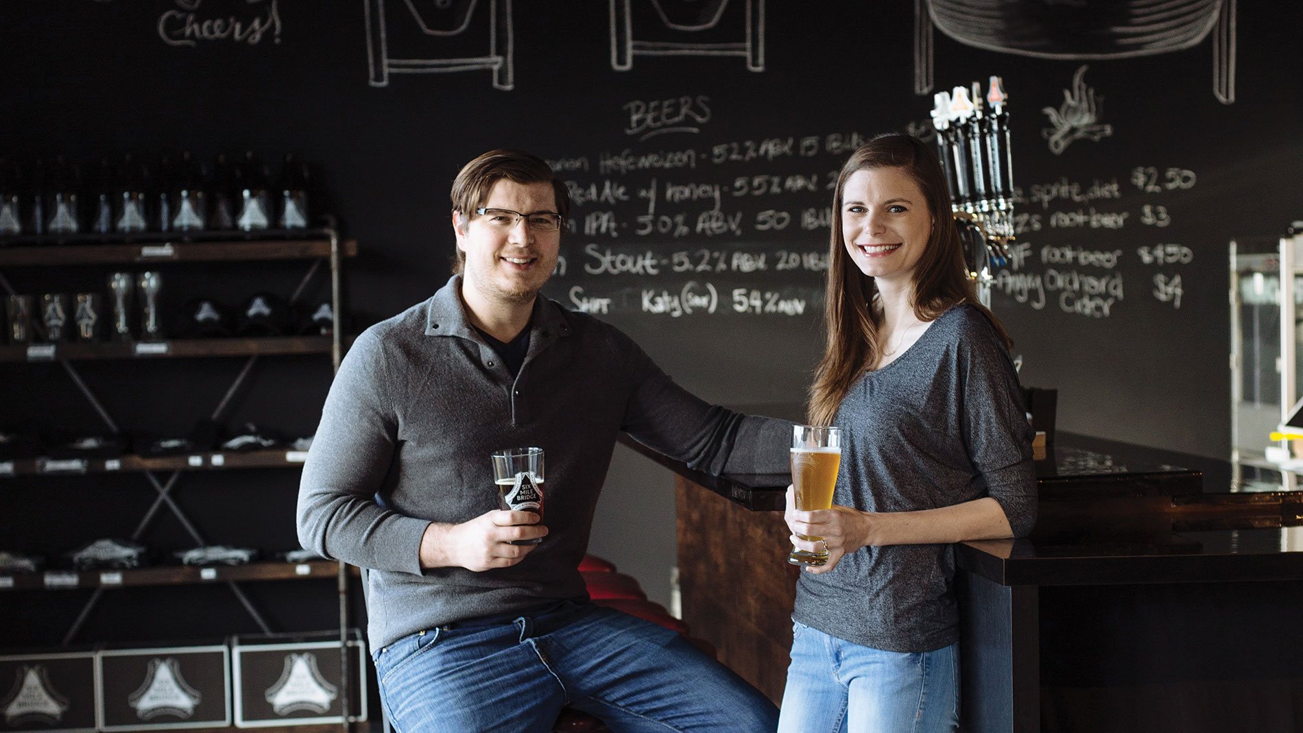 a man and woman drinking beer
