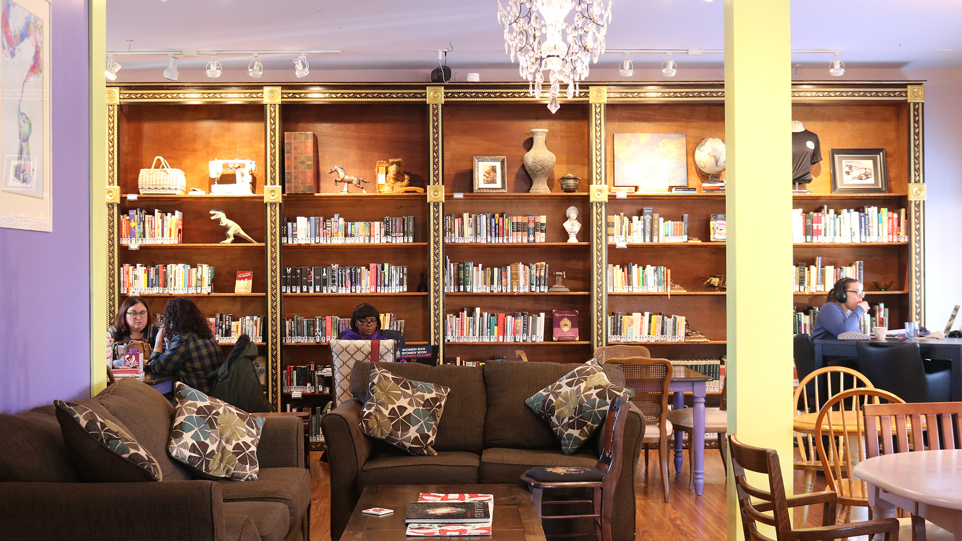 a cafe with walls of bookshelves