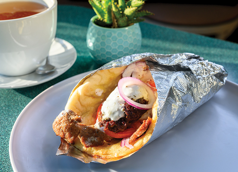 a gyro sandwich wrapped in foil