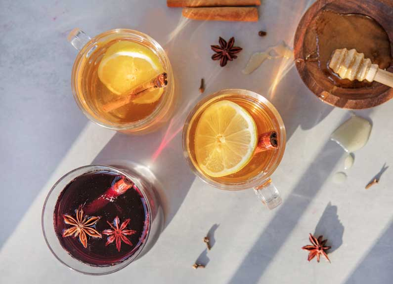 cups hot toddies and mulled wine with star anise and honey
