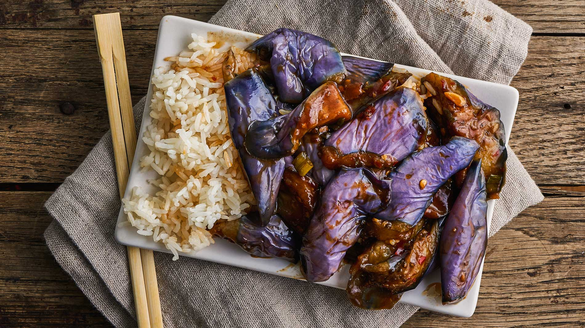 a plate of eggplant in garlic sauce