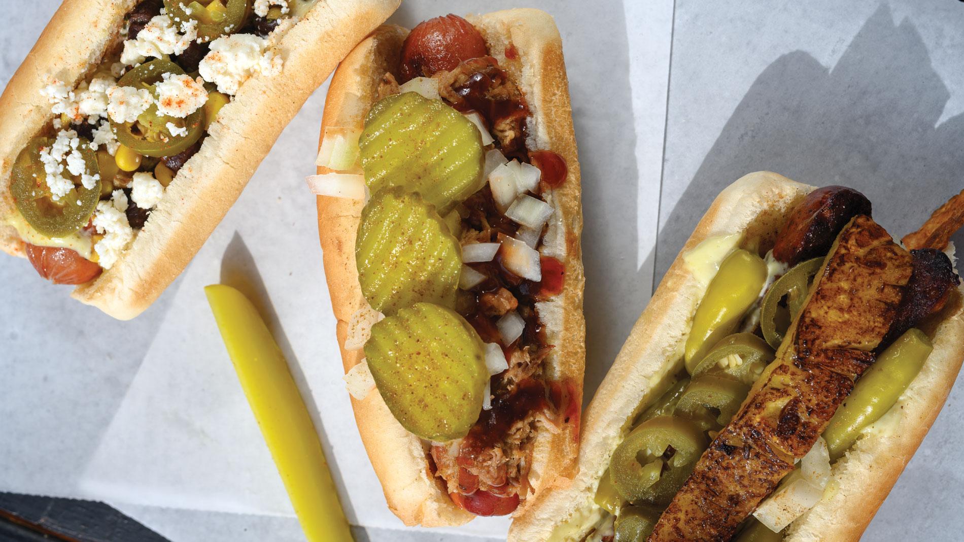 three dressed hot dogs