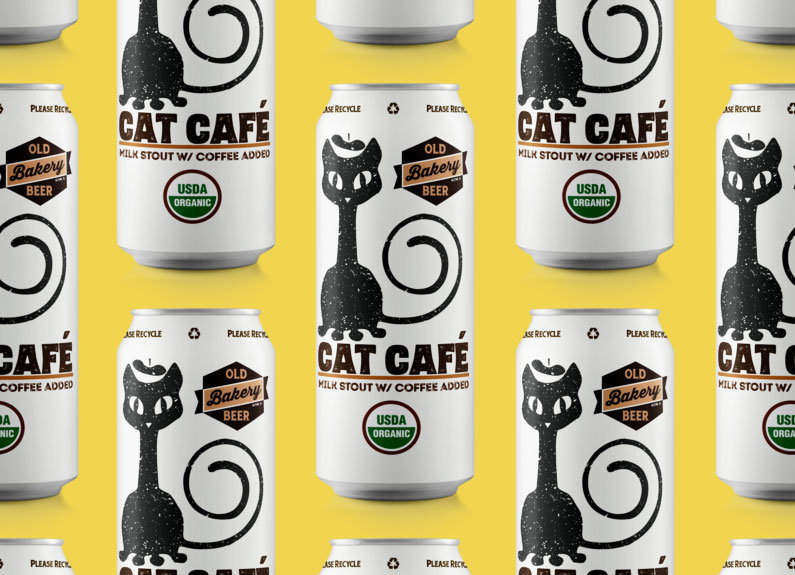 several cans of old bakery beer cat cafe stout on a yellow background
