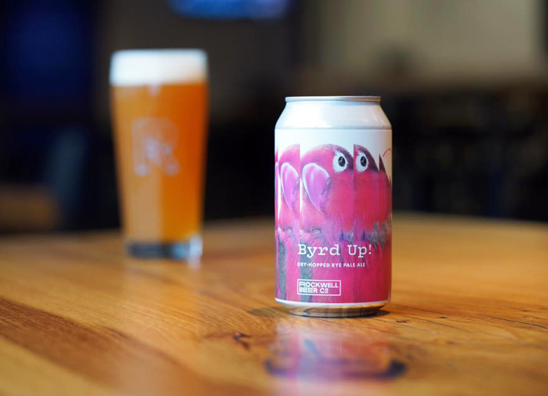 a can of rockwell beer with a pink label