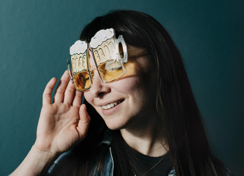 a woman with glasses shaped like beer mugs
