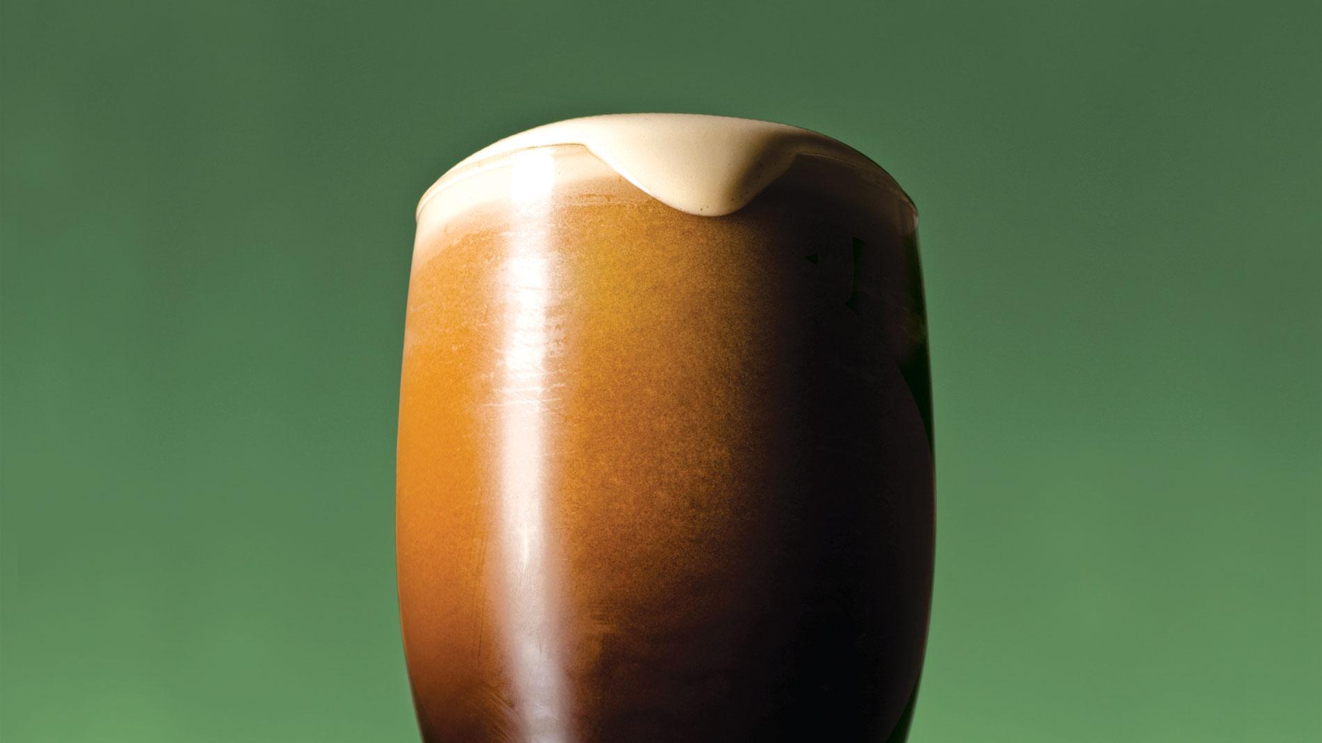 a nitro irish stout on a green background