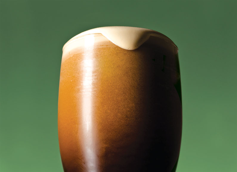 a nitro irish stout on a green background