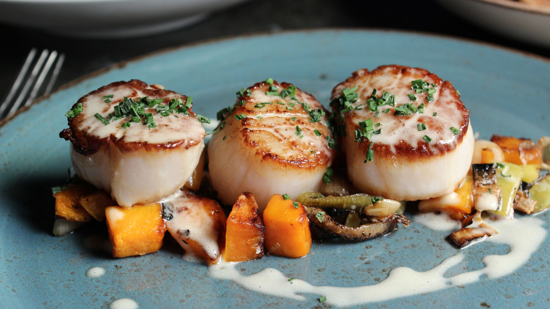 scallops with squash and leeks at boundary at the cheshire in clayton