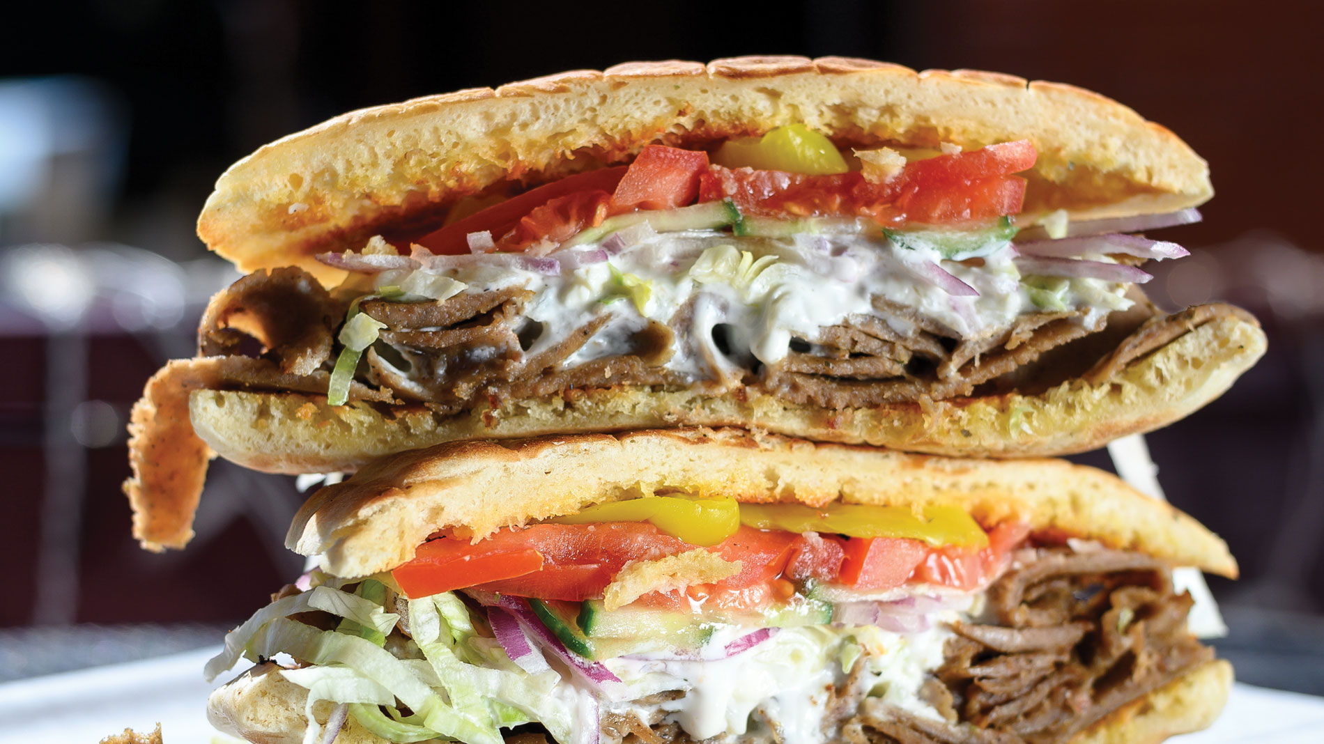 two halves of a gyro sandwich stacked on top of each other