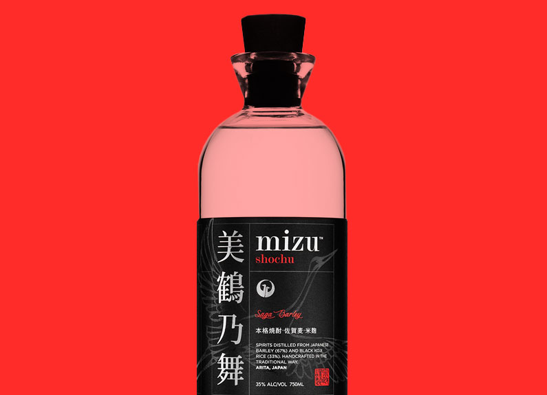 a bottle of shochu on a red background