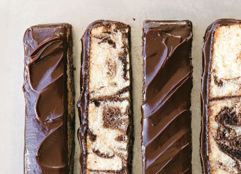 thin slices of marbled cake with fudge icing