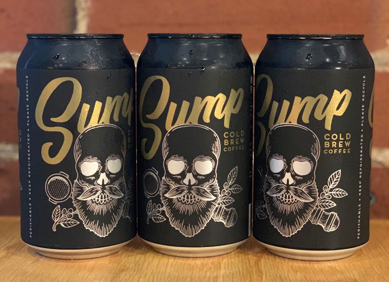 three black cans of cold brew coffee with a bearded skull logo