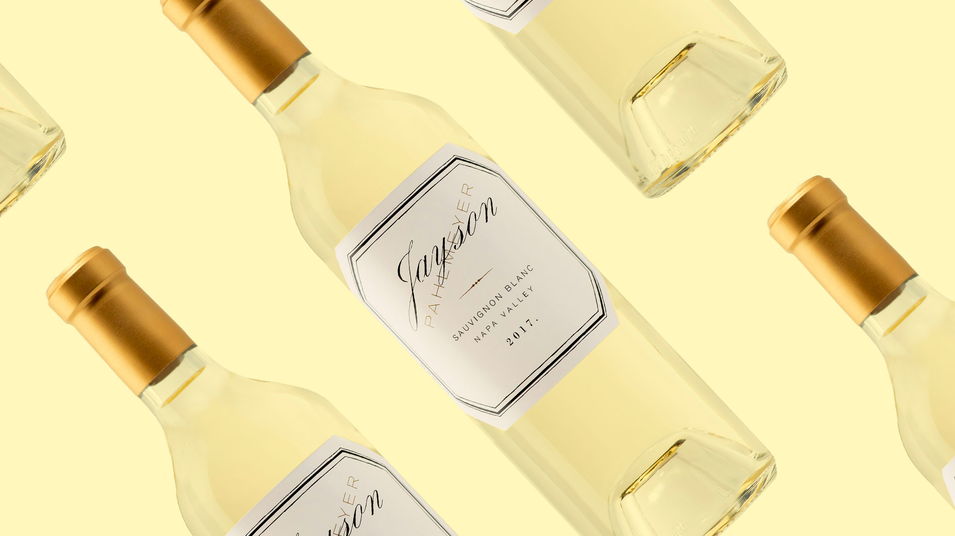 several bottles of white wine against a pale yellow backdrop