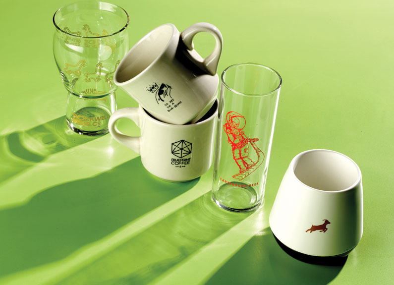 glassware and coffee mugs on a green background