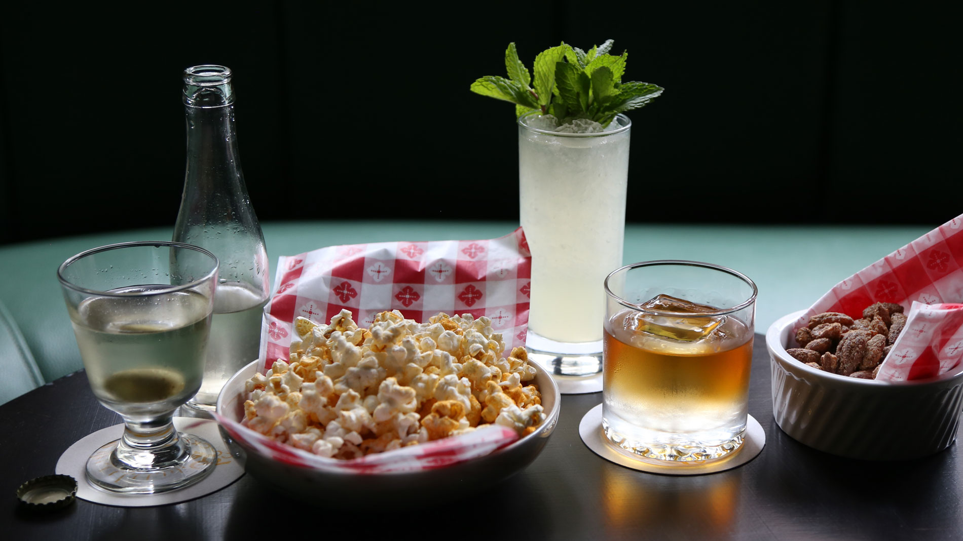 a selection of cocktails and bar snacks on a table