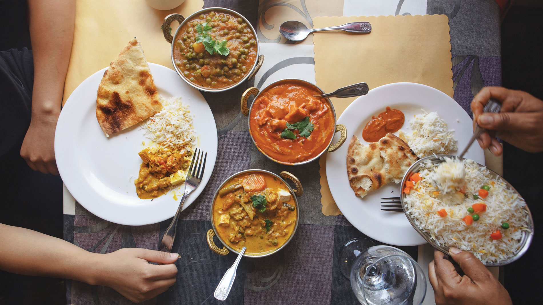 two people sharing an indian meal