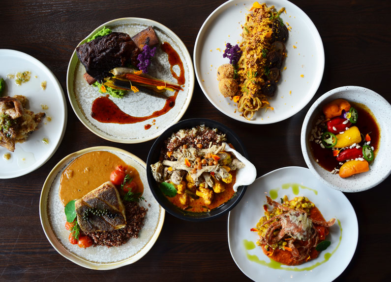 a selection of colorful dishes at akar restaurant