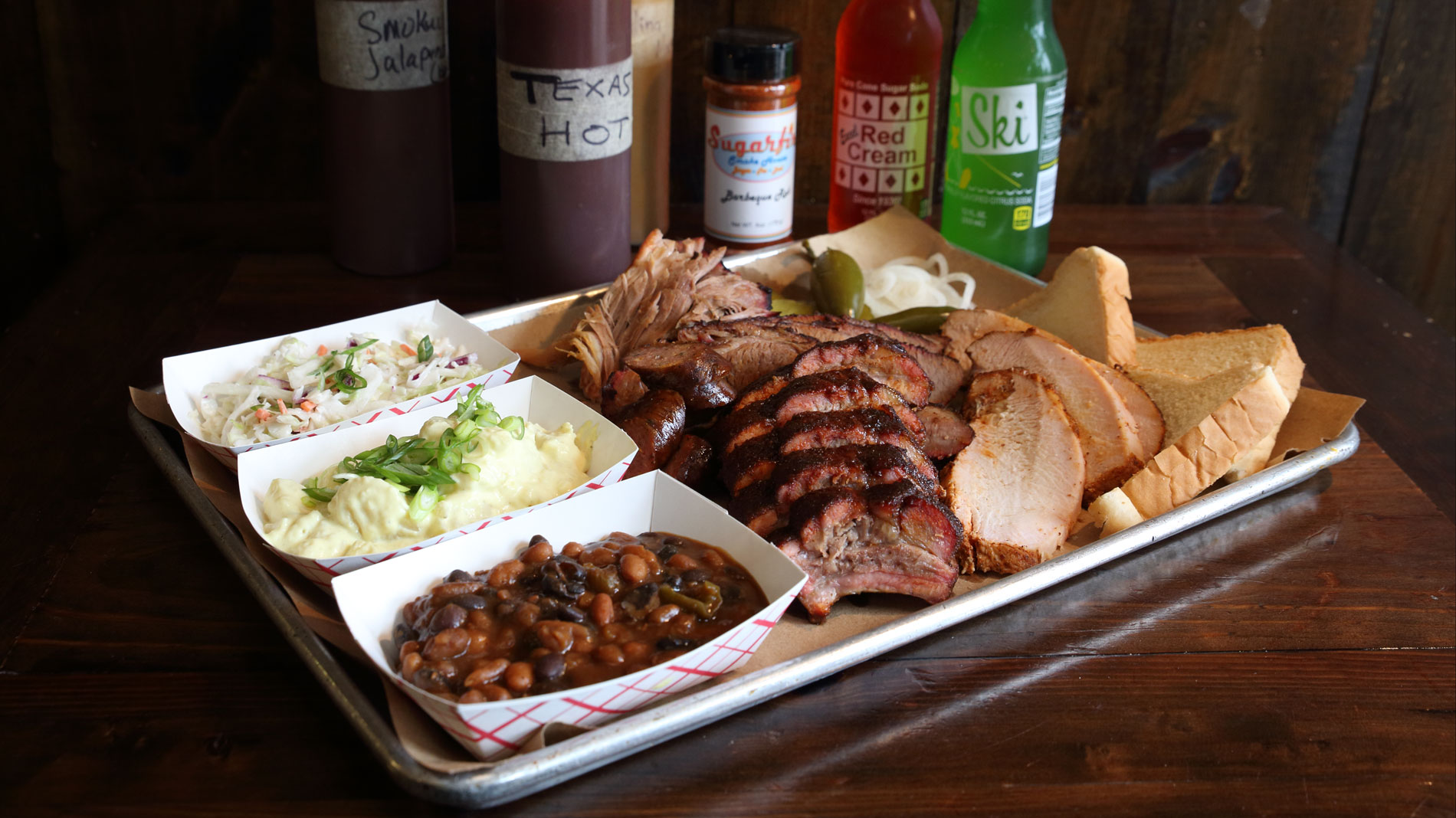 a tray of barbecue and sides