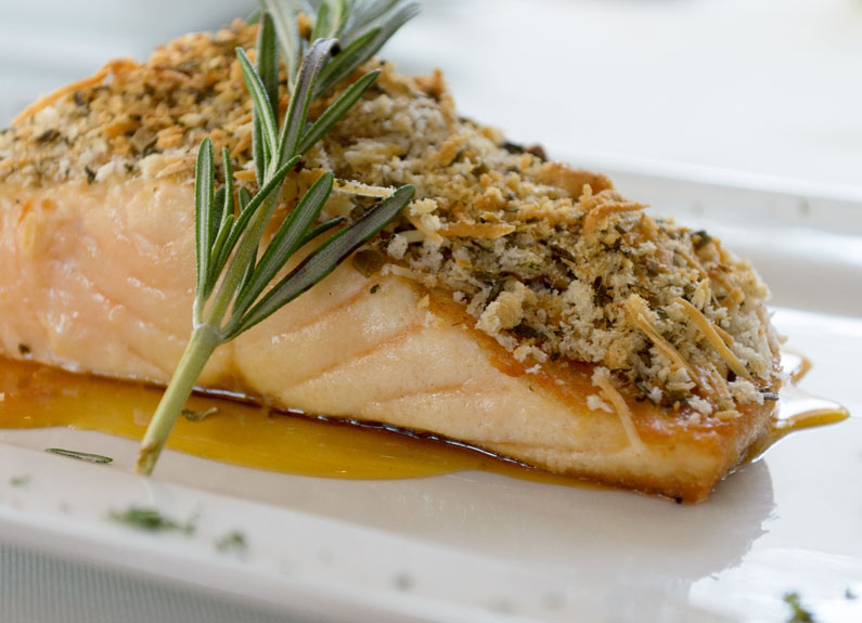 salmon filet with a sprig of rosemary