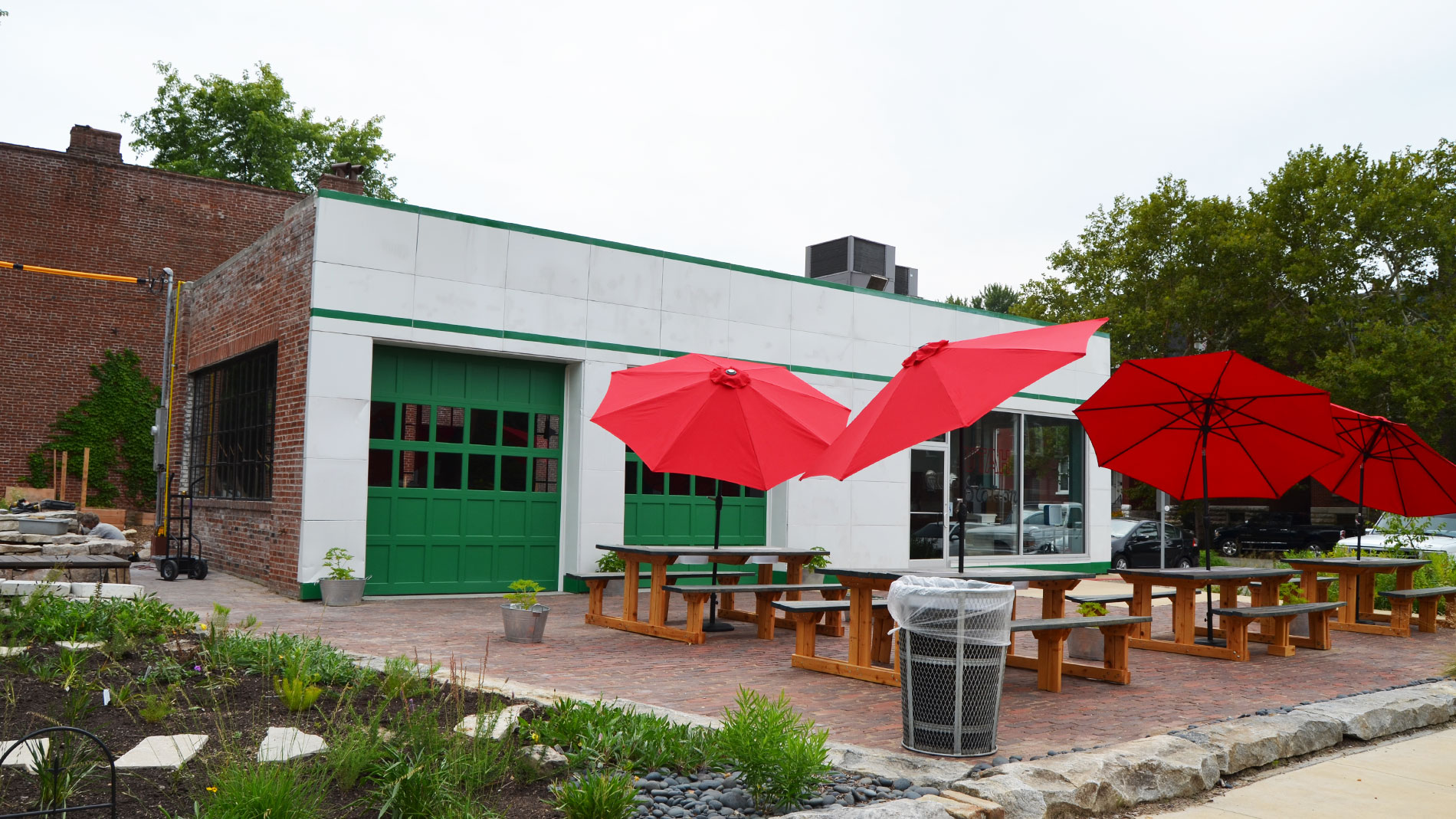 a restaurant patio with red umbrellas