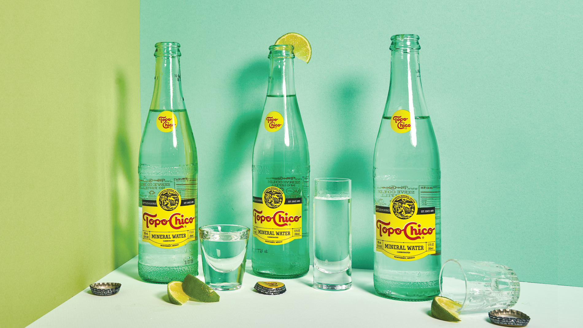 bottles of topo chico with lime wedges