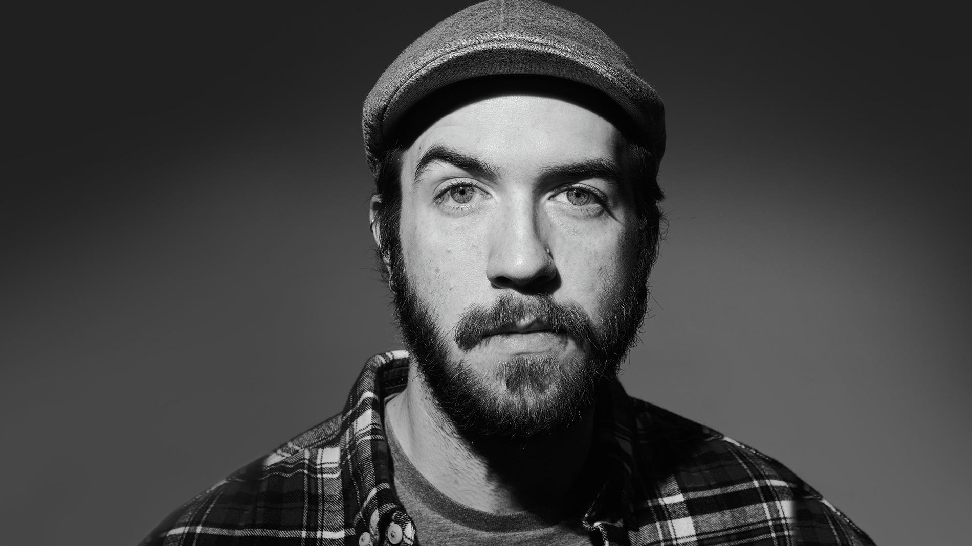 a man with a beard and a cap