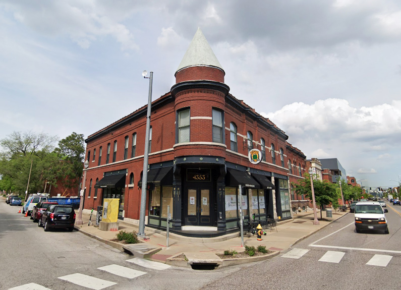 a brick building on a corner in a st. louis