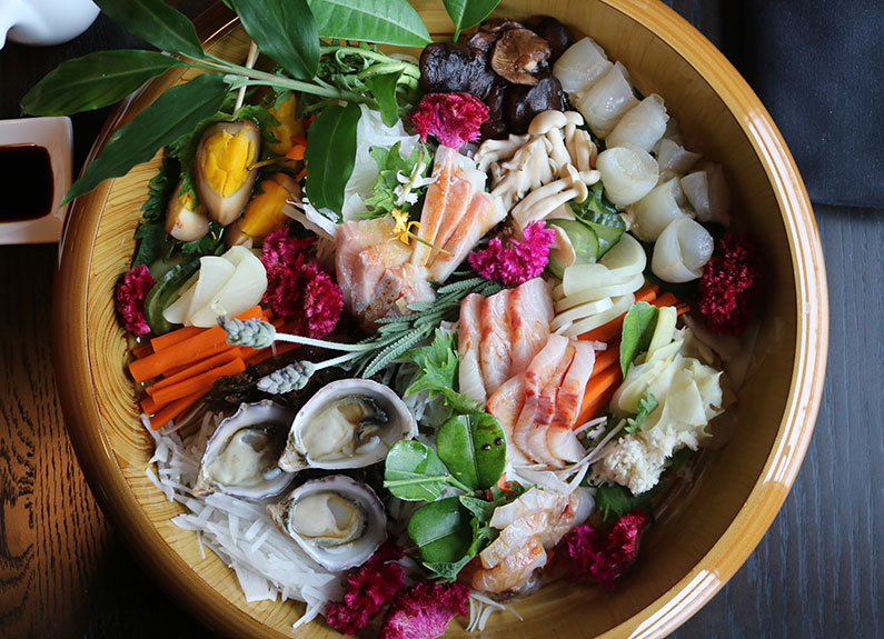 a large bowl of sashimi