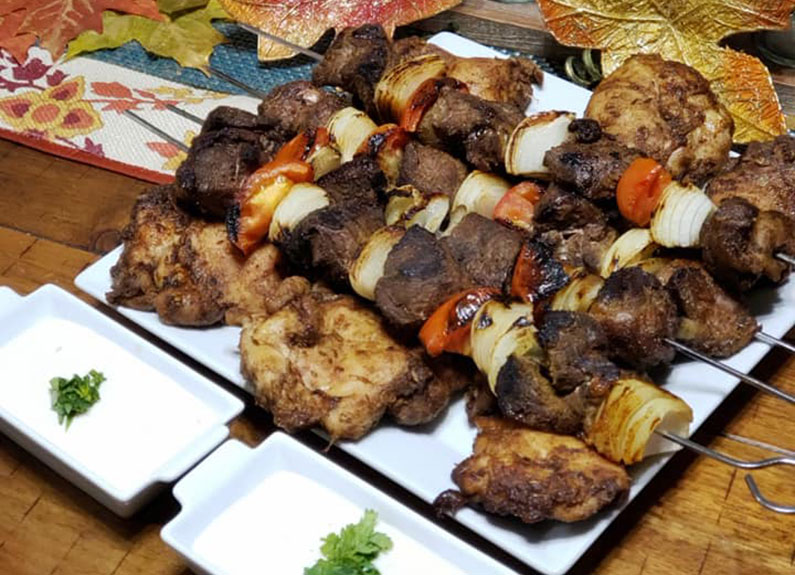 several kebabs on a platter