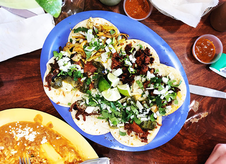 a plate of tacos on a blue plate