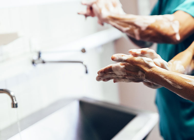 two people washing their hands
