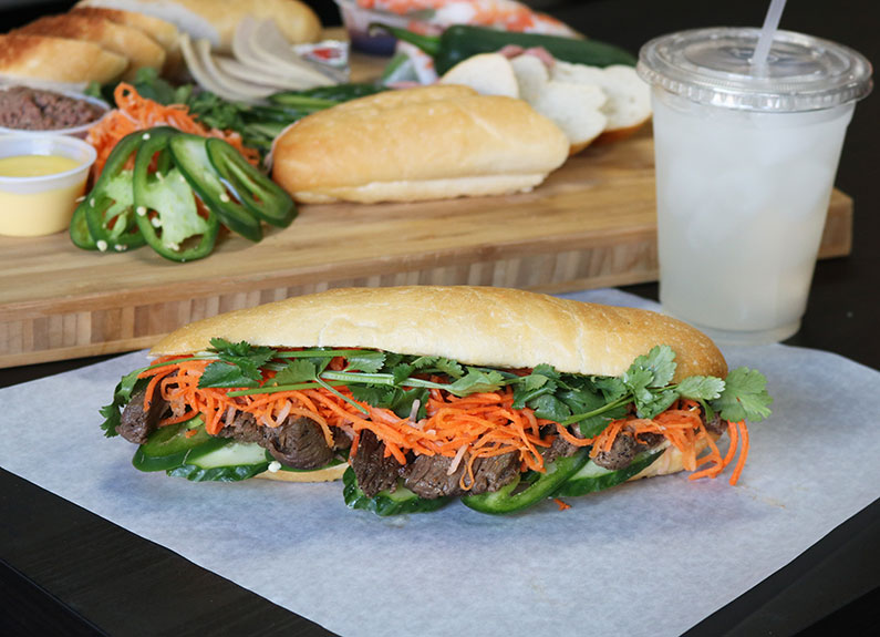 a banh mi sandwich on white paper