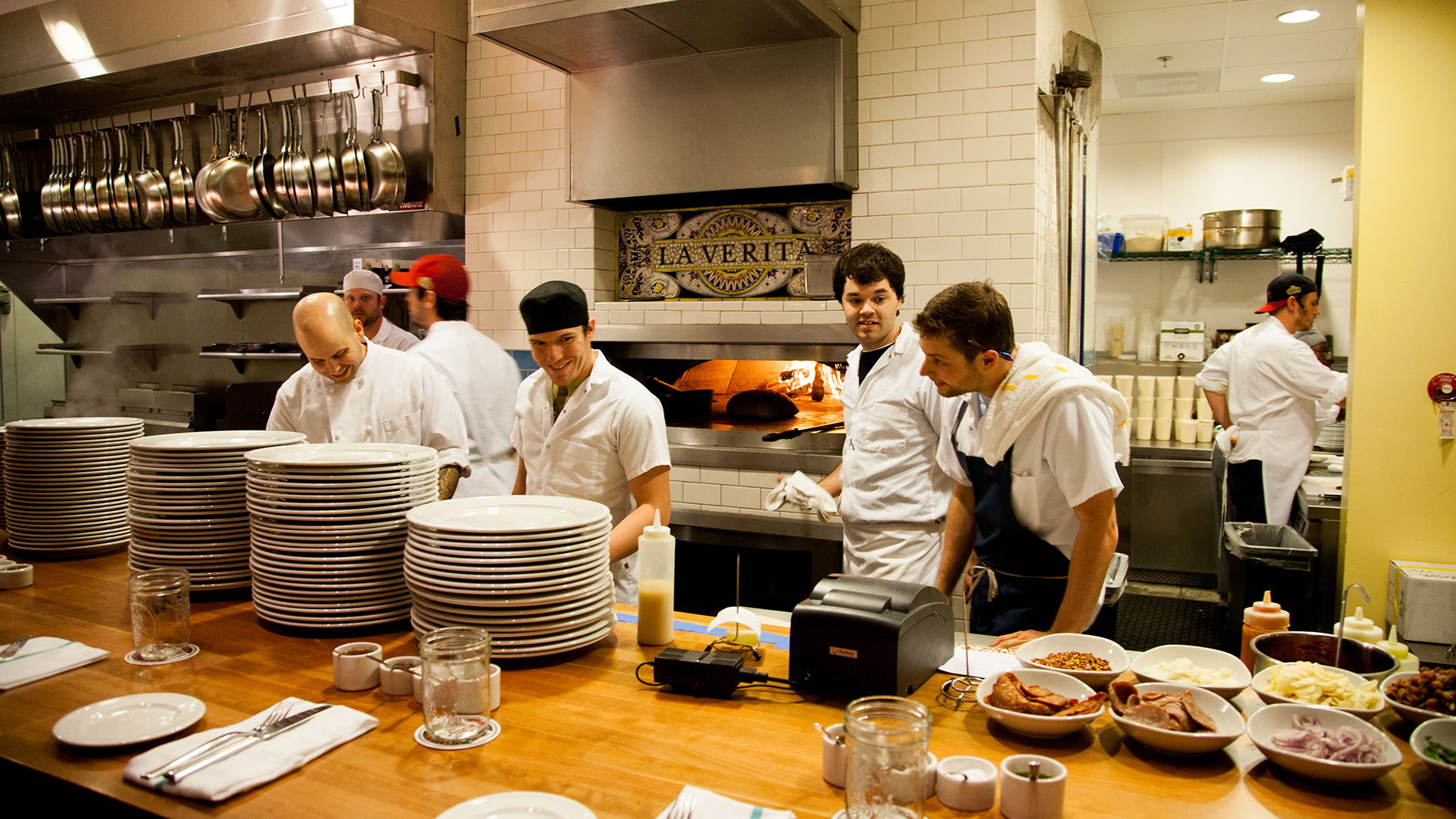 chefs behind a wooden counter