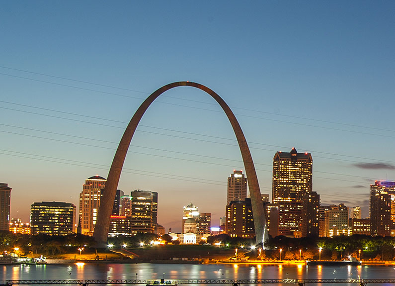 the downtown st louis skyline at sunset