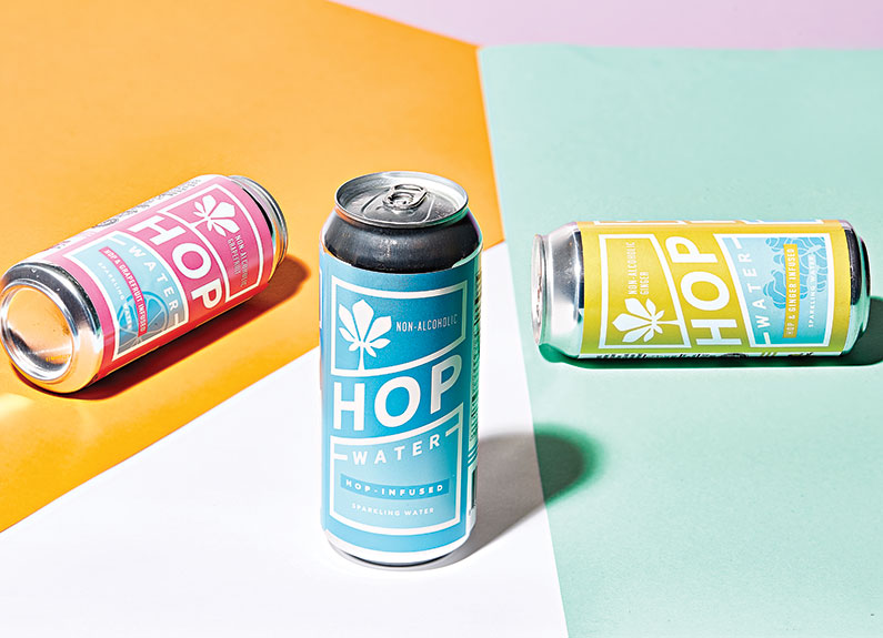 blue cans of hop water on a colorful background