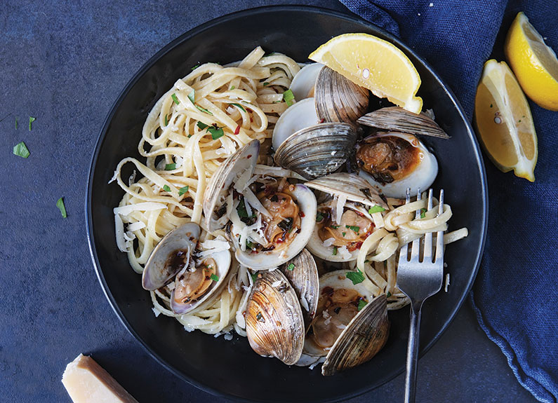 a bowl of pasta with clams