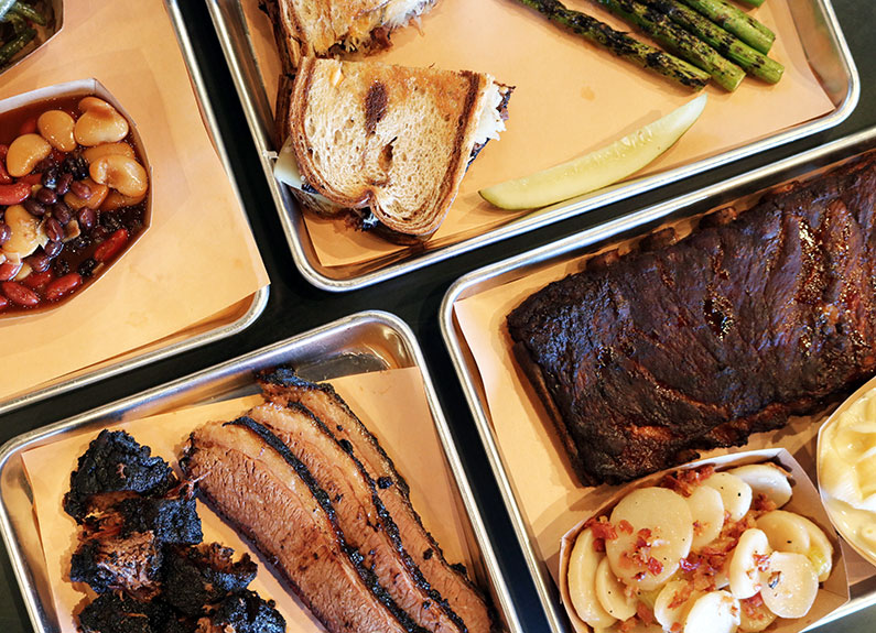 a spread of barbecue items and sides from nubby's bbq in Oakville, Missouri