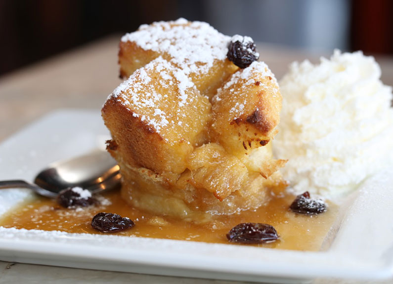 Caramel Brioche Bread Pudding with Cherry Bourbon Sauce from cyrano's in webster groves