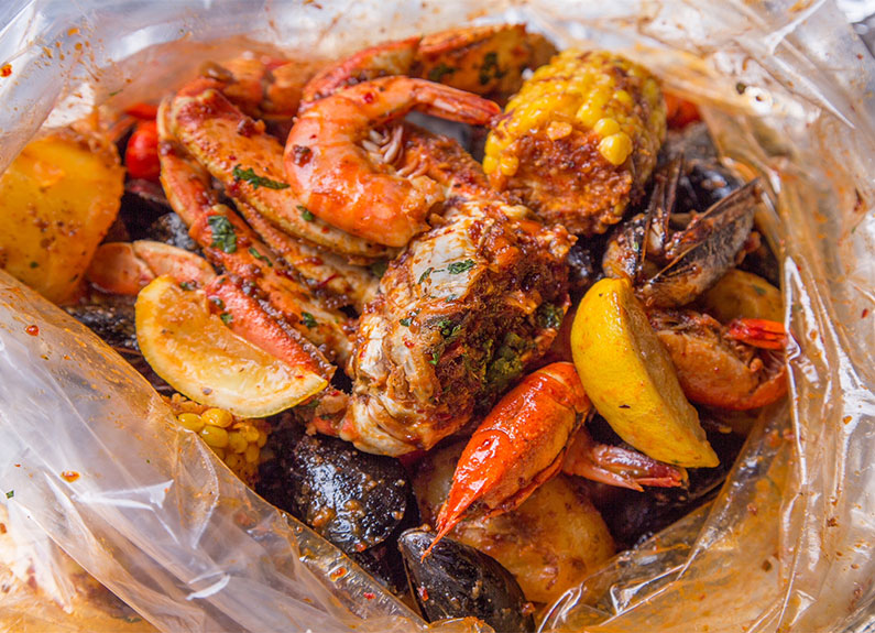 crab n go seafood boil with corn, mussels and shrimp