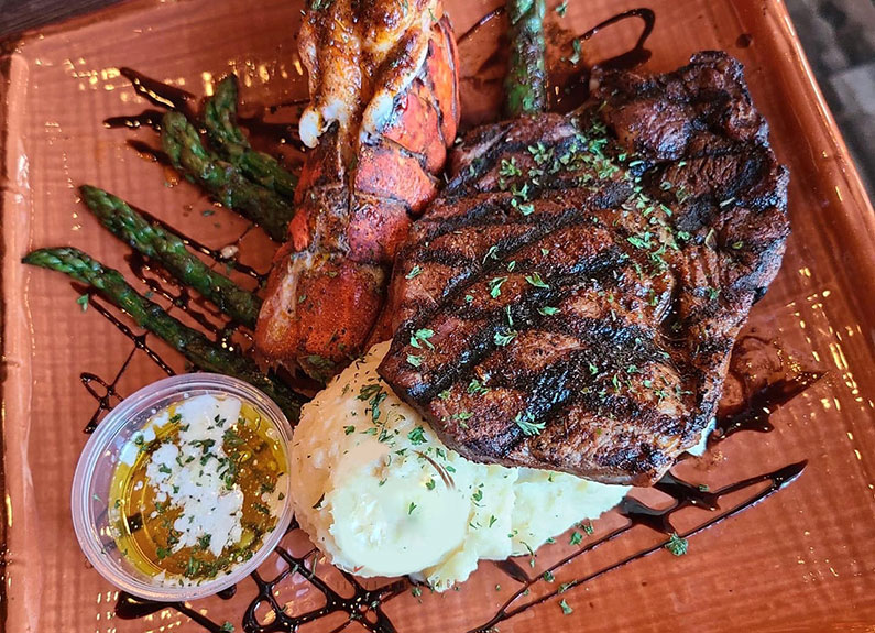 steak with lobster at prime 55 in the delmar loop