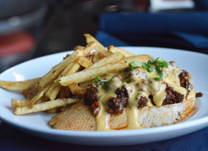 The Sloppy Joe Joe, named for co-owner Wendy Hamilton's brother, is served open-faced and doused in beer cheese sauce on spent-grain sourdough.